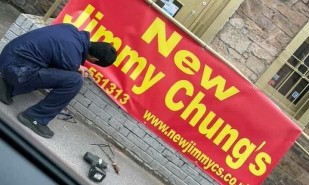 The sign appearing for the new Jimmy Chung's.