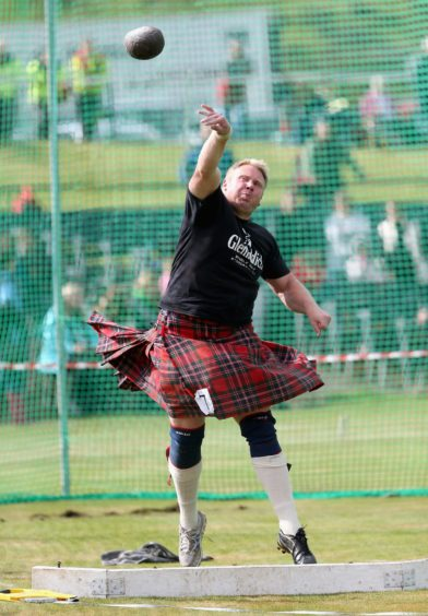 A Competitor throws a weight at the annual Braemer Highland Games at The Princess Royal and Duke of Fife Memorial Park on September 7, 2013 in Braemar, Scotland. Photo by Chris Jackson