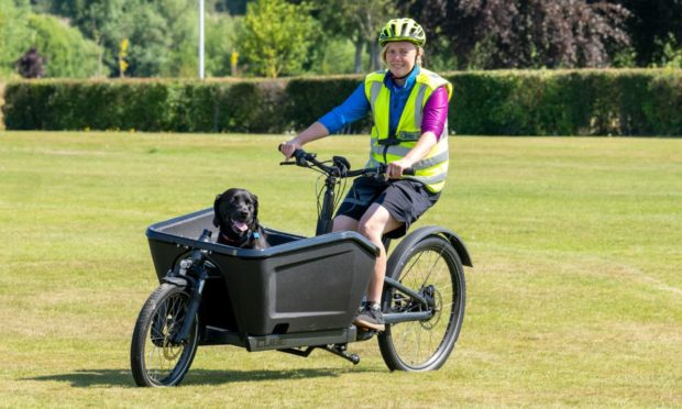 Outfit Moray instructor Anna Bailey with dog Dixon at Elgin Bike Fest. Photo: Jasperimage