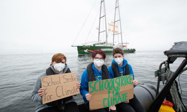 Holly Gillibrand from Fort William staged a protest at Beatrice offshore wind farm in the North sea on Wednesday alongside fellow campaigners Lily Henderson and Dylan Hamilton.