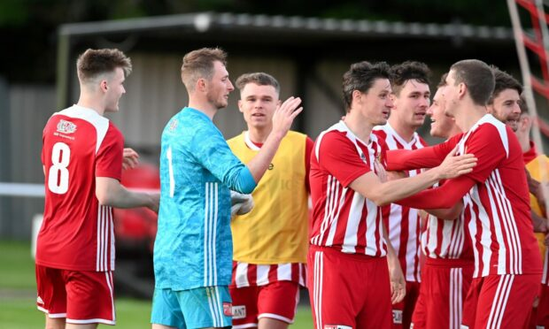 Formartine players celebrate their penalty shoot-out win against Buckie in the Evening Express Aberdeenshire Cup