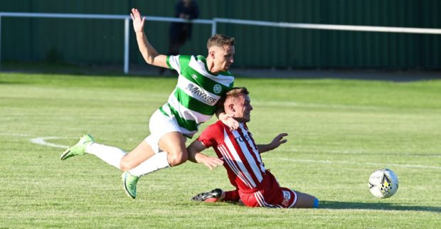 Formartine's Ryan Spink and Buckie's Scott Adams battle for the ball