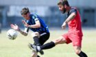 Bridge of Don Thistle's Gary Clark (red) and Hermes Jack Craig battle for the ball.