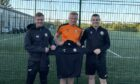 Defender Louis Kane checks in after signing a one-year deal at Fort William. He is pictured with manager Ashley Hollyer, left, and coach Paul Coutts.