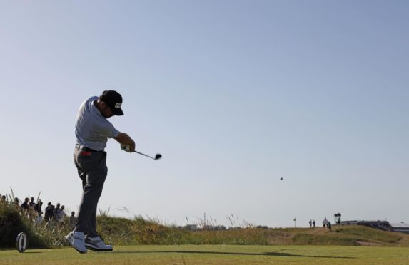 South Africa's Louis Oosthuizen tees off on the 9th hole.