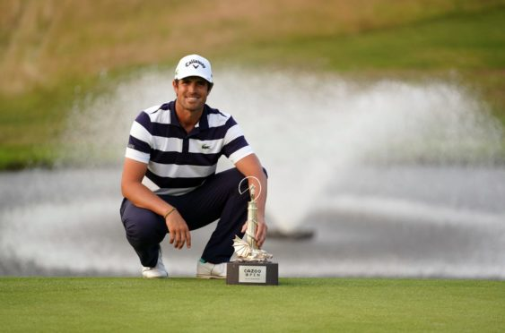 Nacho Elvira celebrates with the Cazoo Trophy after victory over Justin Harding in the play-off.