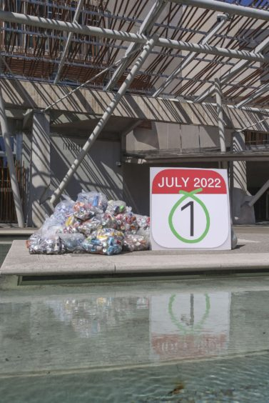Bottles dumped outside the Scottish Parliament