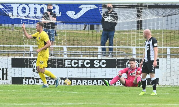 Jordan White celebrates his goal for Ross County at Borough Briggs.  Pictures by Jason Hedges