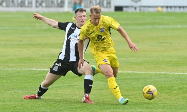 Harry Paton, right, goes on the run against Elgin City. Picture by Jason Hedges