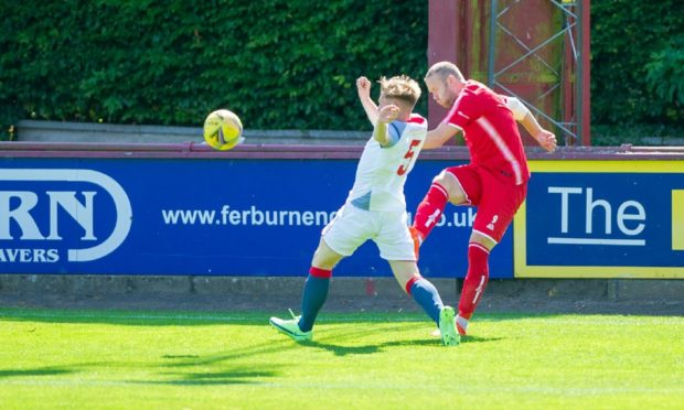Brechin Garry Wood, right, battles with Turriff's Dylan Stuart
