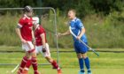 Kilmallie's Daniel Stewart (right) scores the opening goal in the first minute of the game against Kinlochshiel.