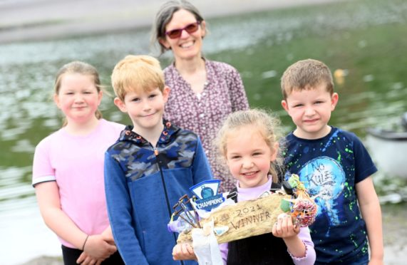 The winners of the Beach Clean Champions series and the Really Rubbish Trophy, the children of Catterline Primary.  Teacher Jane Turner with L-R Catterline Primary pupils Ellie, Nicholas, Katie and Murray with the trophy.    Picture by Kami Thomson