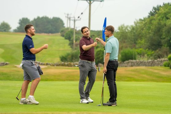 Liam Duncan (l), Scott Crichton and co-leading qualifier Ben Murray (r) at the end of their second qualifying round.