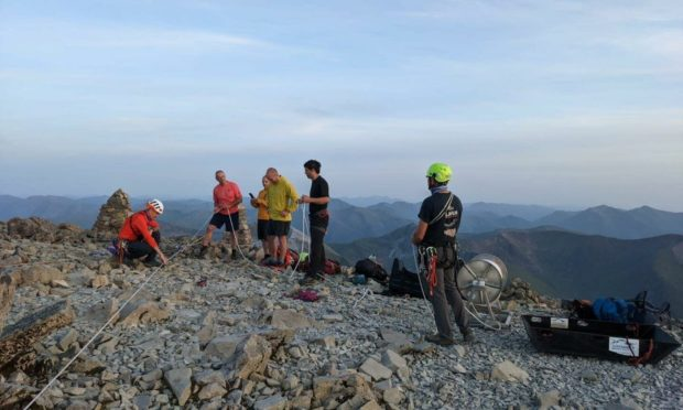 Lochaber Mountain Rescue Team carried out a 12-hour rescue mission to bring a group of crag fast climbers on Ben Nevis to safety.