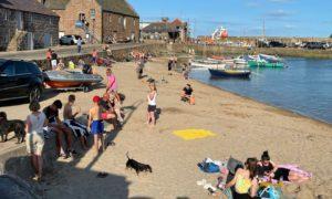 Sunbathers enjoy 26C heat in Stonehaven.