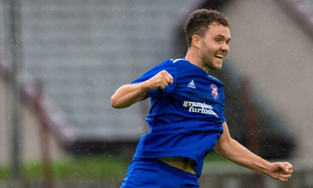Ryan Stuart of Lossie celebrates the first of his three goals at Nairn.