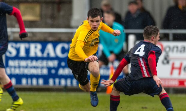 Dylan Mackenzie, left, is back playing for Nairn County