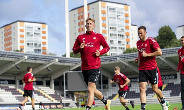 Ross McCrorie trains with his Dons teammates at the Bravida Arena.