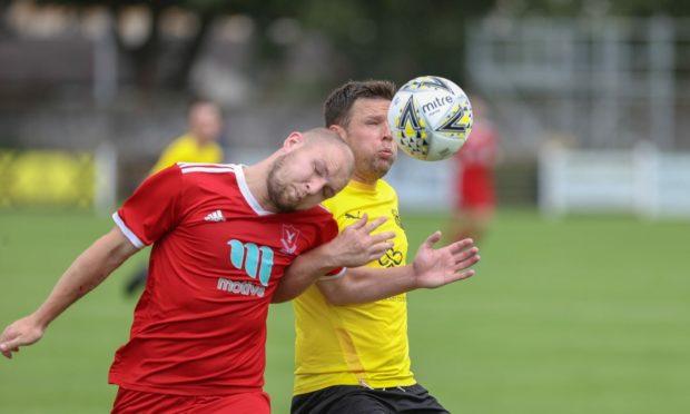 Deveronvale's Dane Ballard, left, and Nairn's Glenn Main battle for possession