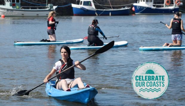 Gayle enjoys a kayak session with Cullen Sea School in the sheltered harbour.