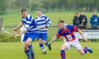 Fraser Mackintosh (Newtonmore) with Fraser Munro (Kingussie). in the MacTavish Cup semi-final in 2019.