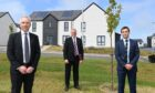 Scotia Homes' Knockhall site in Newburgh. L-R Martin Bruce ( managing director)  Gary Gerard  ( chairman ) and Graham Reid ( land and development director).