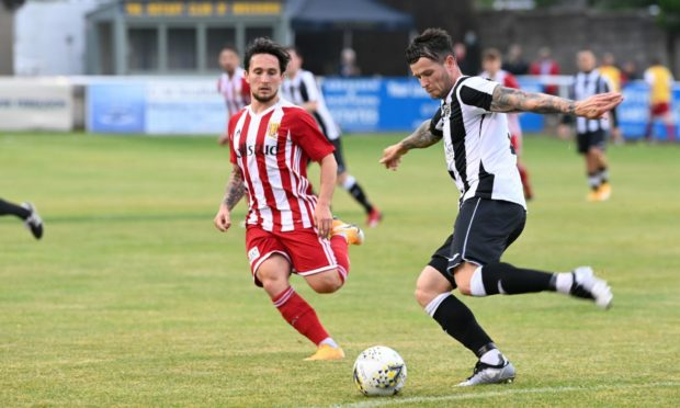 Fraserburgh's Ryan Cowie, right, looks to get away from Formartine's Andrew Greig