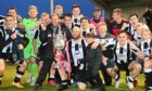 The Fraserburgh players celebrate with the Evening Express Aberdeenshire Cup trophy