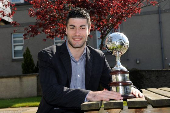Cammy Keith with his Highland League player of the year trophy in 2012