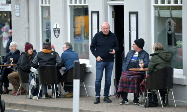 Customers enjoying the outdoor area of Cafe 1 back in May.