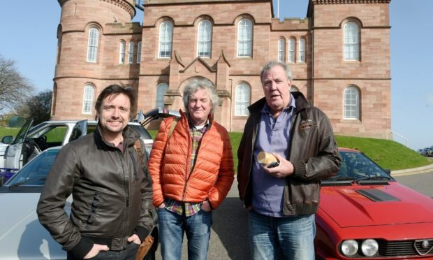 Jeremy Clarkson, James May and Richard Hammond outside Inverness Castle on their last trip to Scotland with The Grand Tour