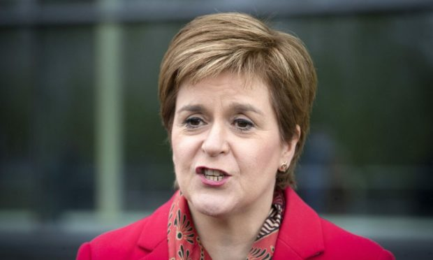 Curtis is accused of sending threatening remarks by email and social media to the First Minister.