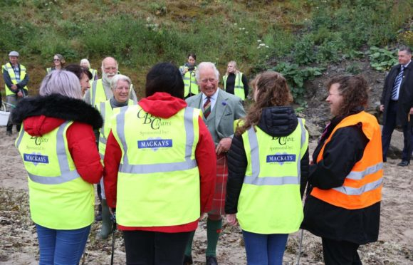 The Prince of Wales at Scrabster Beach with the Caithness Beach Clean Group. Photo: Paul Campbell/PA Wire.