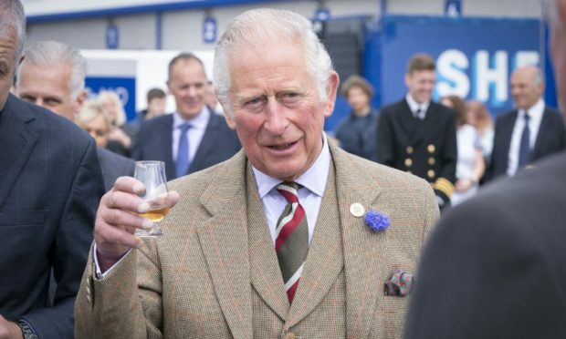 The Prince of Wales, known as the Duke of Rothesay when in Scotland, has a dram of whisky before officially opening the Lerwick Harbour and Scalloway Fish Markets at Shetland Seafood Auctions Ltd at Lerwick Fishmarket, in Lerwick, Shetland, on the second day of a two-day visit to Scotland. Jane Barlow/PA Wire