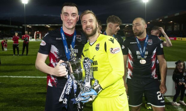 Ross County's Sean Kelly (left) and Scott Fox celebrate with the 2018/19 Championship trophy