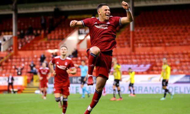 Aberdeen's Christian Ramirez celebrates scoring on his debut.