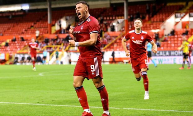 Aberdeen's Christian Ramirez celebrates scoring on his Dons debut.