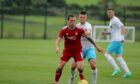 To go with story by Danny Law. Aberdeen midfielder Scott Brown in action during the 1-1 friendly draw against Caley Thistle.  Picture shows; Aberdeen midfielder Scott Brown. Cormack Park. Supplied by Aberdeen FC Date; 08/07/2021
