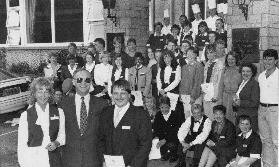 More than 60 staff members receiving their food hygiene awards from hotel general manager Mike Robins, front centre, in 1992.