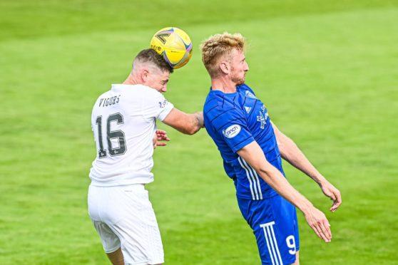 Cove Rangers' Iain Vigurs challenges Peterhead forward Russell McLean.