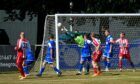 Maud goalkeeper Joe Barbour saves at the front post against Colony Park.