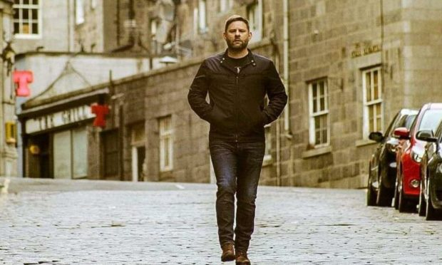 Colin Clyne on the cobbles of Windmill Brae in his new music video, Within Hindsight.