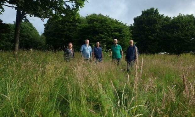 Davie Milne, centre, with residents at Fernielea Park, Aberdeen.