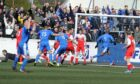 Marvin Andrews, who scored an own goal in the first leg at Dudgeon Park, scores in the 3-1 win for Montrose to see off Brora in the 2015 play-off final.