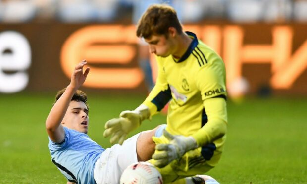 Alexander Robertson, left, playing for Manchester City.