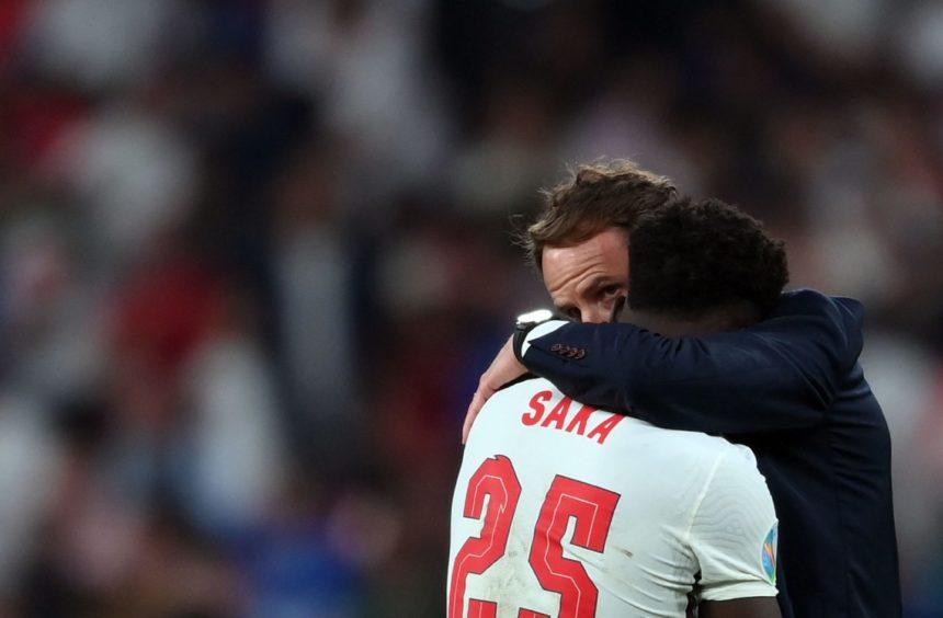 Gareth Southgate comforts Bukayo Saka after the final whistle.