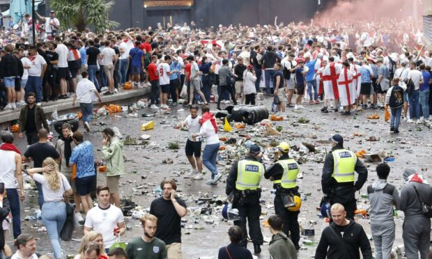 England football fans in Leicester Square before the Euro 2020 final at Wembley