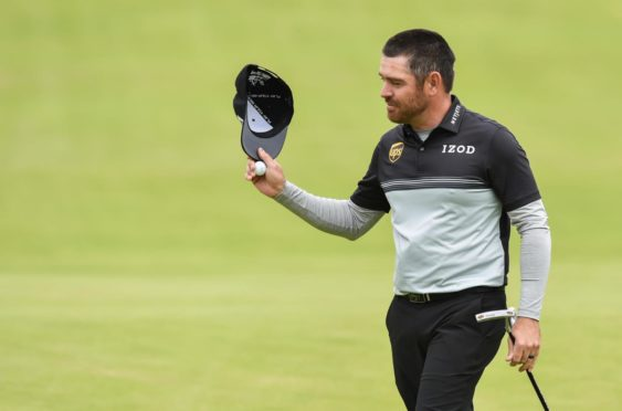 Mandatory Credit: Photo by Greig Cowie/Shutterstock (12205755ct) Louis Oosthuizen acknowledges the crowd after holing a crucial par put on the 18th to lead the open on -6 The British Open Golf, Day One, Royal St George's, Kent, UK - 15 Jul 2021