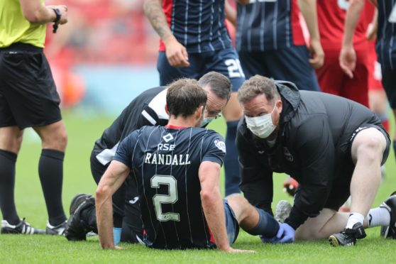 Connor Randall was forced off with an injury at Pittodrie