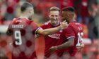 Celebration time. Aberdeen's Lewis Ferguson (centre) celebrates his second goal against BK Hacken in the Europa Conference League.